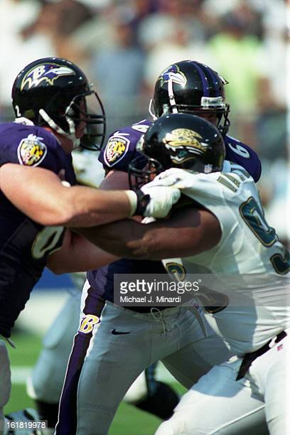 Defensive Tackle Gary Walker of the Jacksonville Jaguars tries to break through the Ravens line during an NFL game against the Baltimore Ravens at...