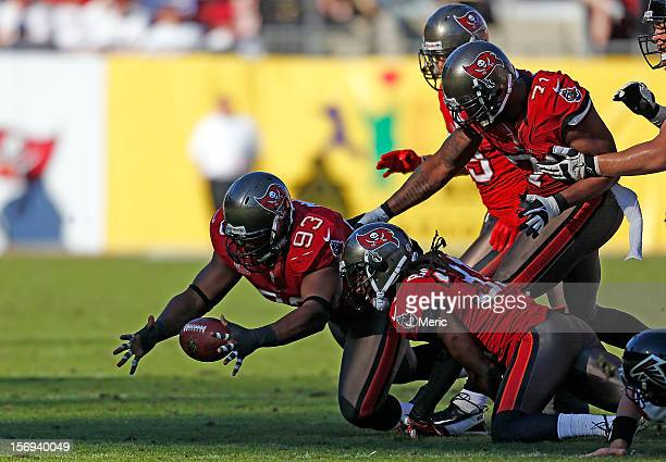 Defensive tackle Gerald McCoy of the Tampa Bay Buccaneers recovers a fumble against the Atlanta Falcons during the game at Raymond James Stadium on...