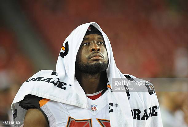 Defensive tackle Gerald McCoy of the Tampa Bay Buccaneers watches the action on the sideline in the second half against the Cincinnati Bengals at...