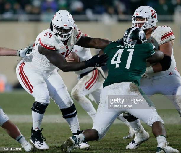 Defensive tackle Gerald Owens of the Michigan State Spartans is blocked by offensive lineman Kamaal Seymour of the Rutgers Scarlet Knights and...