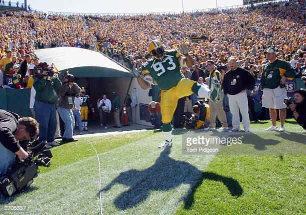 Defensive tackle Gilbert Brown of the Green Bay Packers runs out of the tunnel before the start of the game against the Kansas City Chiefs on October...