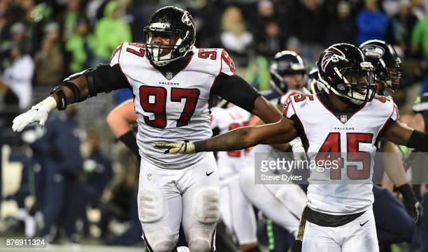 Defensive tackle Grady Jarrett and middle linebacker Deion Jones of the Atlanta Falcons react after the Seattle Seahawks missed a long field goal...
