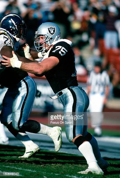 Defensive Tackle Howie Long of the Los Angeles Raiders in action against San Diego Chargers during an NFL football game December 30 1990 at the Los...