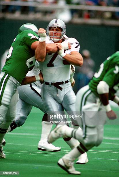Defensive Tackle Howie Long of the Los Angeles Raiders in action against the Philadelphia Eagles during an NFL football game November 8 1992 at...