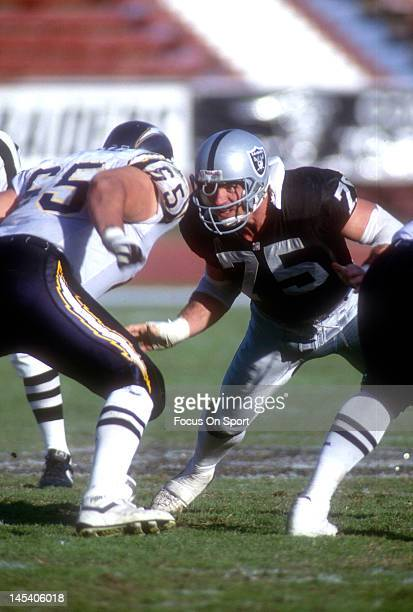 Defensive Tackle Howie Long of the Los Angeles Raiders looks to get past guard David Richards of the San Diego Chargers during an NFL football game...