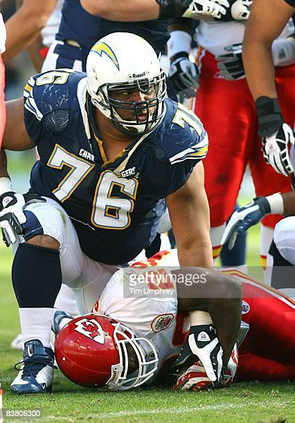 Defensive tackle Jamal Williams of the San Diego Chargers gets up after tackling running back Dantrell Savage in a game against the Kansas City...