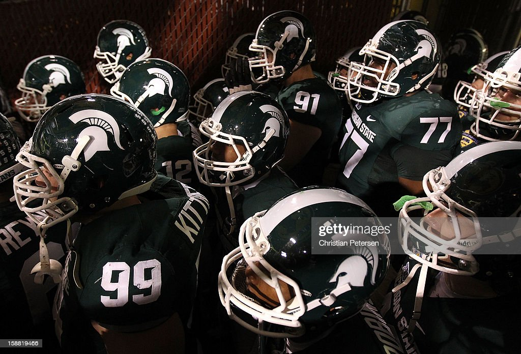 Defensive tackle James Kittredge #99 of the Michigan State Spartans leads teammates out of the tunnell before the Buffalo Wild Wings Bowl against the TCU Horned Frogs at Sun Devil Stadium on December 29, 2012 in Tempe, Arizona. The Spartans defeated the Horned Frogs 17-16.