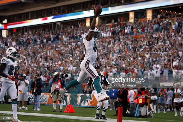Defensive tackle Jason Taylor of the Miami Dolphins jumps into the end zone after scoring a touchdown against of the Minnesota Vikings in the fourth...