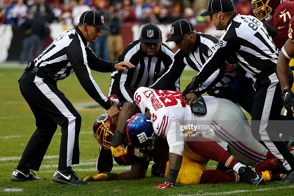 Defensive tackle Jay Bromley #96 of the New York Giants has a physical altercation with tackle Morgan Moses #76 of the Washington Redskins in the fourth quarter at FedExField on November 29, 2015 in Landover, Maryland.