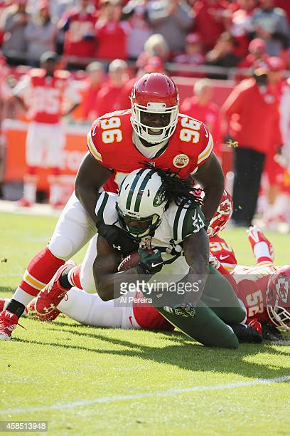 Defensive Tackle Jaye Howard of the Kasas City Chiefs makes a stop of Running Back Chris Ivory of the New York Jets at Arrowhead Stadium on November...