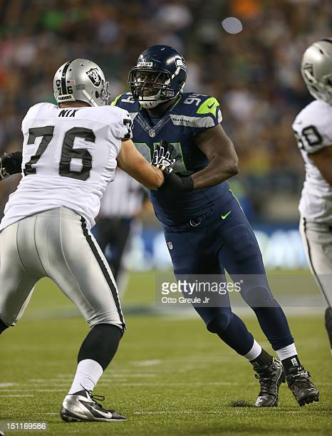 Defensive tackle Jaye Howard of the Seattle Seahawks battles Lucas Nix of the Oakland Raiders at CenturyLink Field on August 30, 2012 in Seattle,...