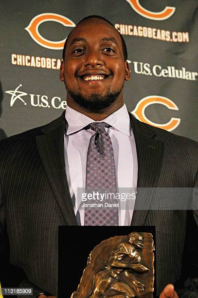 Defensive tackle J'Marcus Webb of the Chicago Bears poses with his award during the 2010 Brian Piccolo Award ceremony at Halas Hall on April 26 2011...