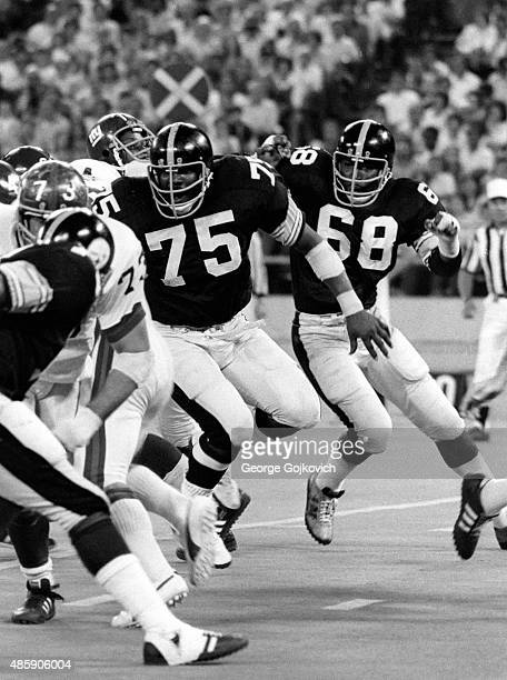 Defensive tackle Joe Greene and defensive end LC Greenwood of the Pittsburgh Steelers pursue the play during a preseason game against the New York...