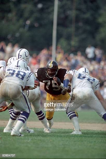 Defensive tackle Joe Greene of the Pittsburgh Steelers faces the Baltimore Colts offensive line at Municipal Stadium on September 14 1980 in...