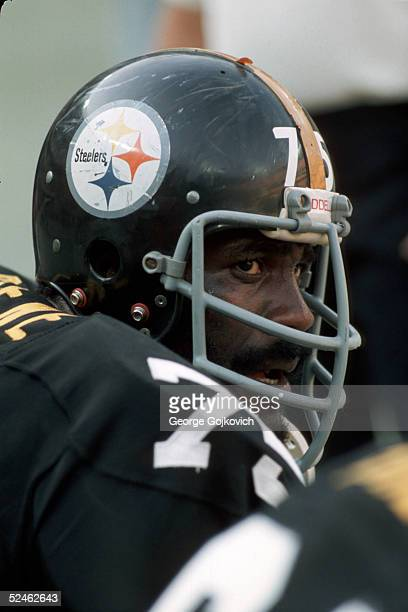 Defensive tackle Joe Greene of the Pittsburgh Steelers on the bench during a game at Three Rivers Stadium in 1975 in Pittsburgh Pennsylvania