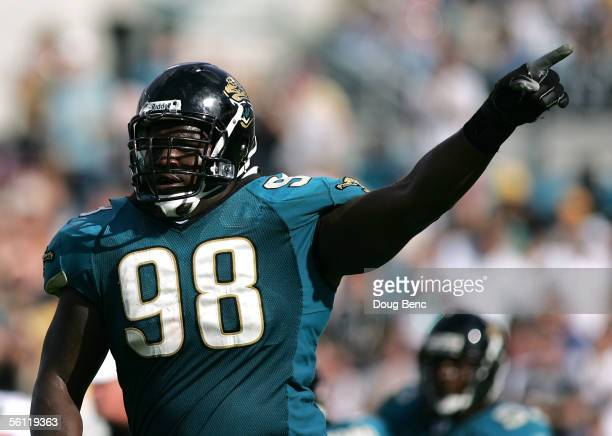 Defensive tackle John Henderson of the Jacksonville Jaquars celebrates after his team recovered a fumble against the Houston Texans on November 6,...