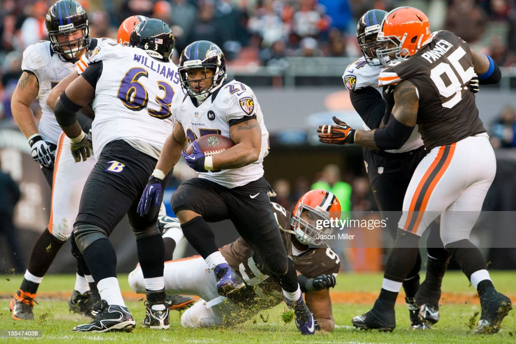 Defensive tackle John Hughes #93 and defensive end Juqua Parker #95 of the Cleveland Browns are unable to tackle running back Ray Rice #27 of the Baltimore Ravens during the second half at Cleveland Browns Stadium on November 4, 2012 in Cleveland, Ohio. The Ravens defeated the Browns 25-15.