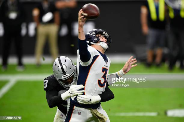Defensive tackle Johnathan Hankins of the Las Vegas Raiders hits quarterback Drew Lock of the Denver Broncos in the first half of their game at...