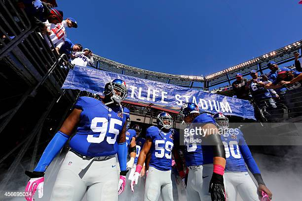 Defensive tackle Johnathan Hankins outside linebacker Devon Kennard defensive tackle Markus Kuhn and defensive end Jason PierrePaul of the New York...