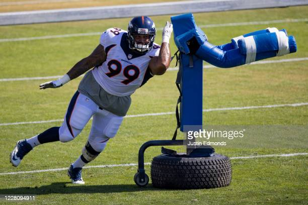 Defensive tackle Jurrell Casey of the Denver Broncos swipes past a piece of equipment during a training session at UCHealth Training Center on August...