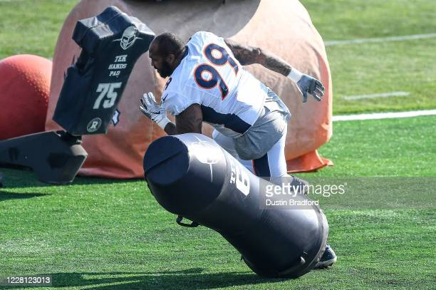 Defensive tackle Jurrell Casey of the Denver Broncos works with equipment during a training session at UCHealth Training Center on August 20, 2020 in...