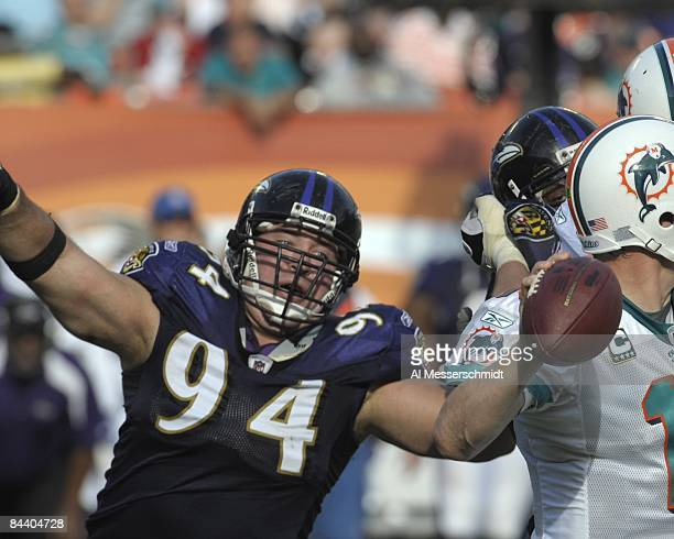 Defensive tackle Justin Bannan of the Baltimore Ravens rushes the pocket against the Miami Dolphins in an NFL Wildcard Playoff Game at Dolphins...
