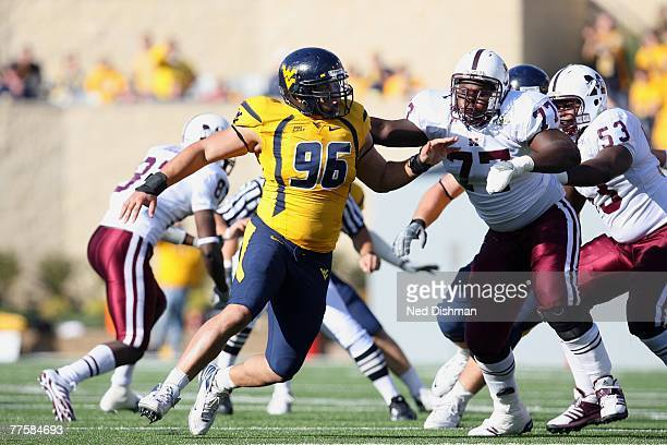 Defensive tackle Keilen Dykes of the West Virginia University Mountaineers rushes the passer against Mike Brown of the Mississippi State Bulldogs on...