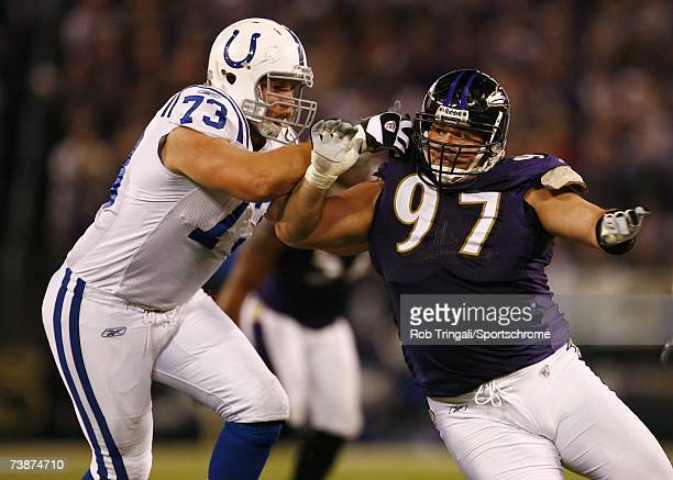 Defensive tackle Kelly Gregg of the Baltimore Ravens rushes the passer as Jake Scott of the Indianapolis Colts blocks during the AFC Divisional...