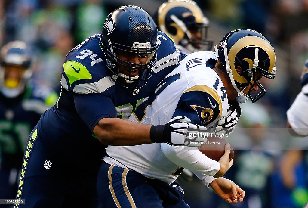 Defensive tackle Kevin Williams #94 of the Seattle Seahawks sacks quarterback Shaun Hill #14 of the St. Louis Rams during the fourth quarter of the game at CenturyLink Field on December 28, 2014 in Seattle, Washington.