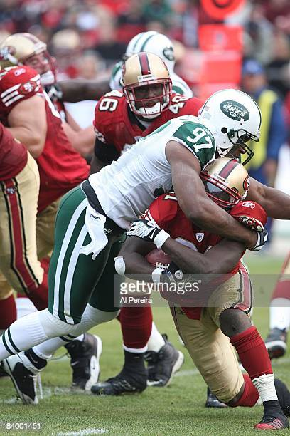 Defensive Tackle Kris Jenkins of the New York Jets stops Running Back Frank Gore of the San Francisco 49ers on December 7, 2008 at Candlestick Park,...