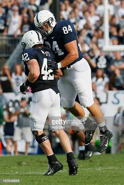 Defensive tackle Kyle Baublitz and linebacker Michael Mauti of the Penn State Nittany Lions celebrate stopping the Navy Midshipmen during the second...