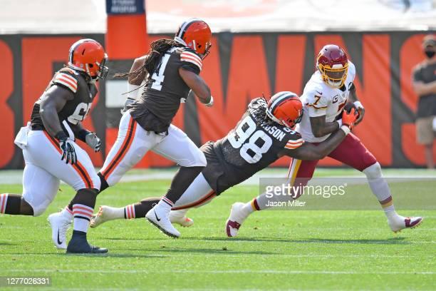 Defensive tackle Larry Ogunjobi defensive end Adrian Clayborn and defensive tackle Sheldon Richardson of the Cleveland Browns all pursue quarterback...