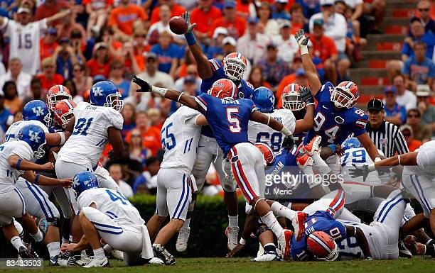 Defensive tackle Lawrence Marsh of the Florida Gators blocks a second quarter field goal from the Kentucky Wildcats during the game at Ben Hill...