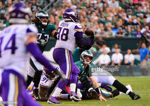 Defensive tackle Linval Joseph of the Minnesota Vikings makes a fumble recovery to run 64 yards for a touchdown against the Philadelphia Eagles...