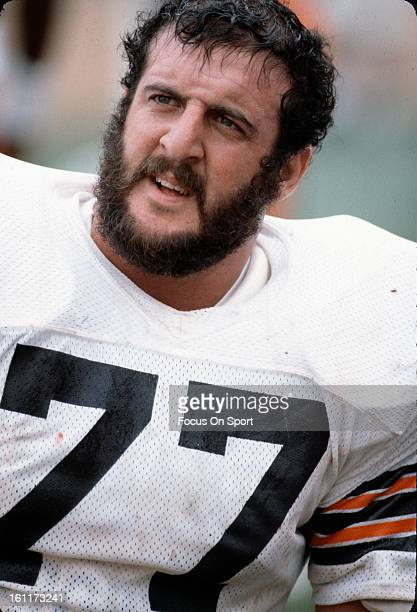 Defensive Tackle Lyle Alzado of the Cleveland Browns looks on from the bench during an NFL football game circa 1979 Alzado played for the Browns from...