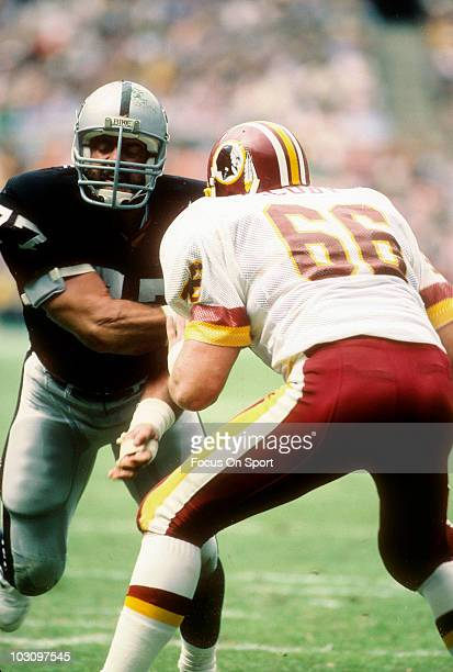 Defensive Tackle Lyle Alzado of the Los Angeles Raiders is blocked by guard Joe Jacoby of the Washington Redskins October 2 1983 during an NFL...