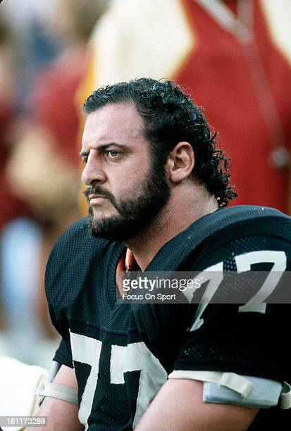Defensive Tackle Lyle Alzado of the Los Angeles Raiders looks on from the bench against the Washington Redskins during an NFL football game October 2...