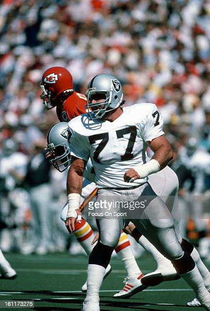 Defensive Tackle Lyle Alzado of the Los Angeles Raiders pursues the play against the Kansas City Chiefs during an NFL football game October 16 1984...