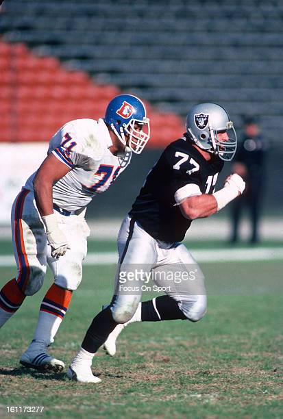 Defensive Tackle Lyle Alzado of the Los Angeles Raiders pursues the play against the Denver Broncos during an NFL football game November 13 1983 at...