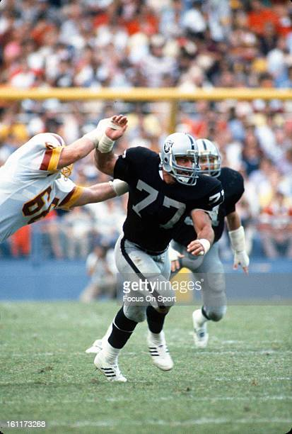 Defensive Tackle Lyle Alzado of the Los Angeles Raiders rushes past Joe Jacoby of the Washington Redskins during an NFL football game October 2 1983...