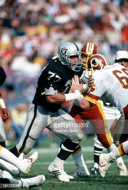 Defensive Tackle Lyle Alzado of the Los Angeles Raiders rushes up against Joe Jacoby of the Washington Redskins during an NFL football game October 2...