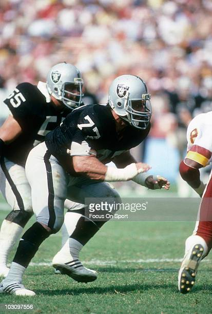 Defensive Tackle Lyle Alzado of the Los Angeles Raiders starts to pursue the play against the Washington Redskins October 2 1983 during an NFL...