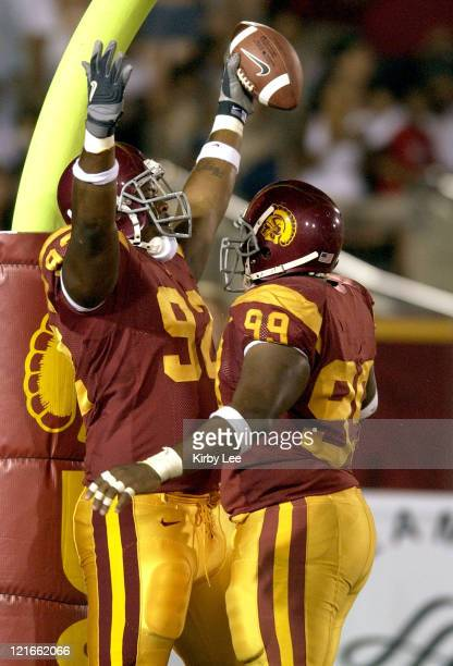 USC defensive tackle Manuel Wright is congratulated by Mike Patterson after scoring on a 20yard fumble recovery in the fourth quarter of 490 victory...