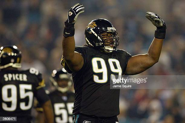 Defensive tackle Marcus Stroud of the Jacksonville Jaguars puts his arms in the air during the game against the Tampa Bay Buccaneers on November 30,...