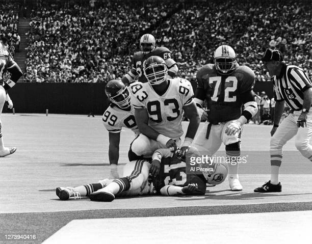 Defensive Tackle Marty Lyons of the New York Jets brings down Quarterback Dan Marino of the Miami Dolphins during the New York Jets vs Miami Dolphins...