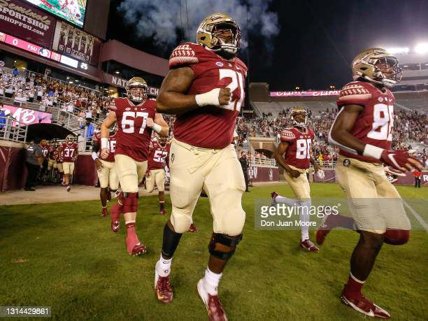 Defensive Tackle Marvin Wilson of the Florida State Seminoles runs on the field before the start of the game against the North Carolina Tar Heels at...