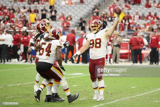 Defensive tackle Matthew Ioannidis of the Washington Redskins celebrates with linebacker Mason Foster after a turnover during the final moments of...