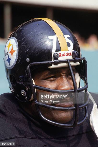 Defensive tackle Mean Joe Greene of the Pittsburgh Steelers watches play during an NFL game on October 23 1977 at Three Rivers Stadium in Pittsburgh...