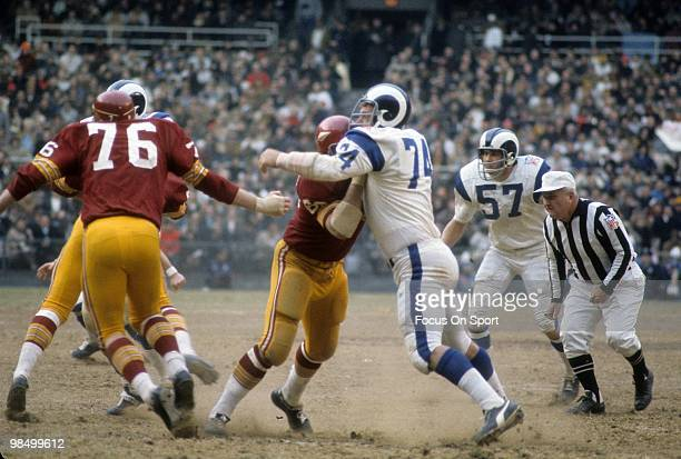 Defensive Tackle Merlin Olsen of the Los Angeles Rams in action against the Washington Redskins circa 1969 during an NFL football game at RFK Stadium...