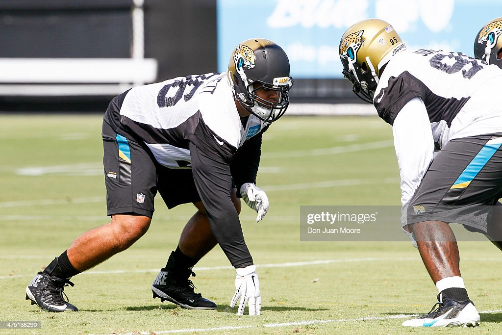 Defensive Tackle Michael Bennett #96 of the Jacksonville Jaguars works out during OTA's at Everbank Field Stadium at the Florida Blue Health and Wellness Practice Fields on May 27, 2015 in Jacksonville, Florida.